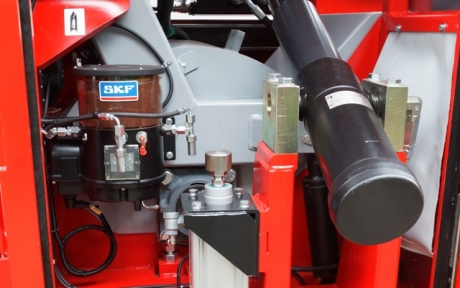 Central lubrication system for pumpkin seed harvester